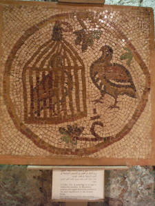 "From the Museum of Popular Traditions in downtown Amman. The caption reads, ""A partridge in a cage is visited by another. In Byzantine sources, the caged bird is the symbol of the soul imprisoned in the human body."""